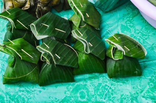 Laotian steamed fish is wrapped in banana leaf.