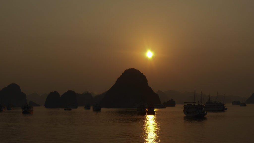 Ha Long Bay sunset. Image courtesy of Jeroen van Luin / Creative Commons.