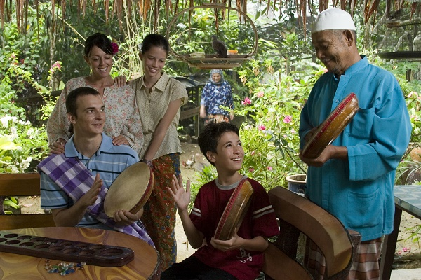 Learning traditional Malay music at a homestay in Langkawi. Image courtesy of Tourism Malaysia.