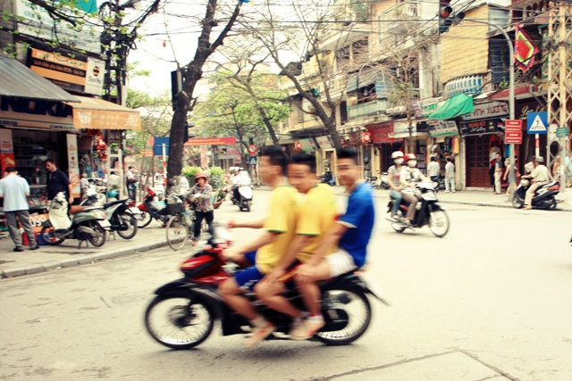 Motorcycle riders in the Old Quarter, Hanoi, Vietnam