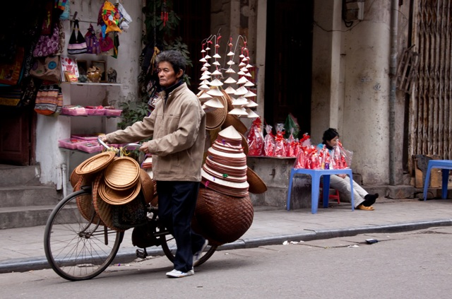 Conical hat & basket vendor in the Old Quarter, Hanoi, Vietnam