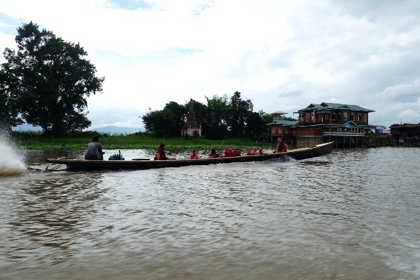 Boat entering Inle Lake village, Myanmar