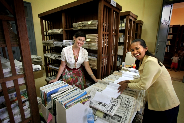Australian volunteer helps sorting and cataloguing books at the National Library of Cambodia